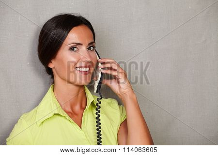 Charismatic Woman Smiling While Talking On Phone