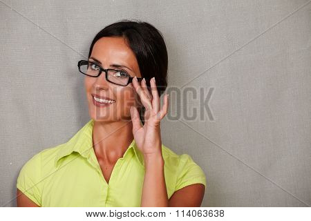Happy Woman Smiling With Fingers On Glasses