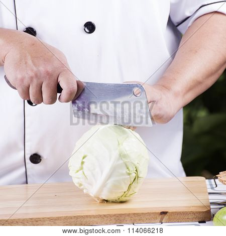 Chef Cutting Green Cabbage