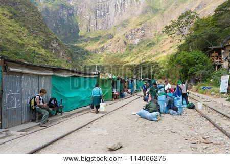 People And Baggages On Railway Track To Machu Picchu, Peru