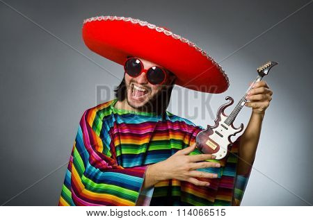 Man wearing sombrero in dark studio
