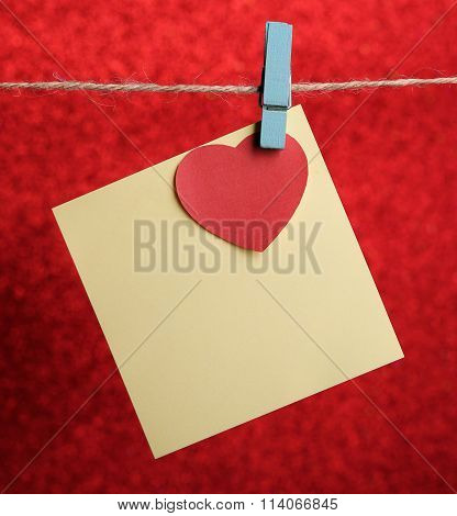 Blank Note With Red Heart Against Red Background