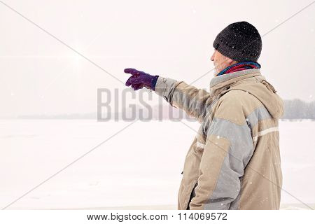 Man Close To The Frozen River In Magic Winter