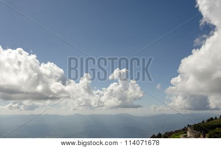Mountain And Cloudy Sky With A Selfie Couple On The Scenic View Area