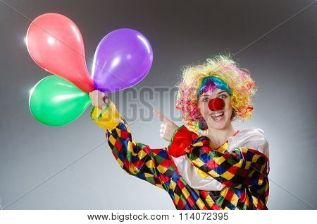 Clown with balloons in funny concept