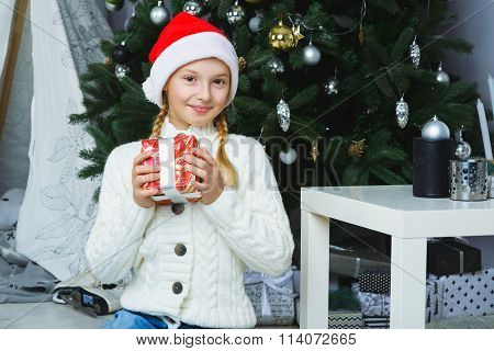 Happy girl holding gifts. Waiting for Christmas. Celebration. New Year.
