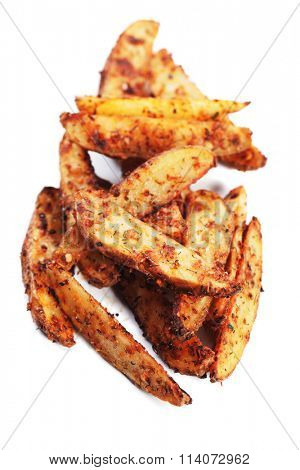 Spicy roasted potato wedges isolated on white background