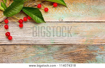 Red ripe cherries on a background of old barn boards