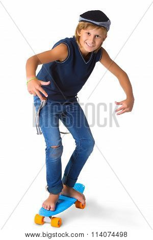 Cute blonde boy or teenager in full length casual style blue jeans posing and showing thumbs up isol