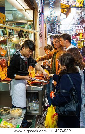 People at marketplace in Macao, buying traditional meat