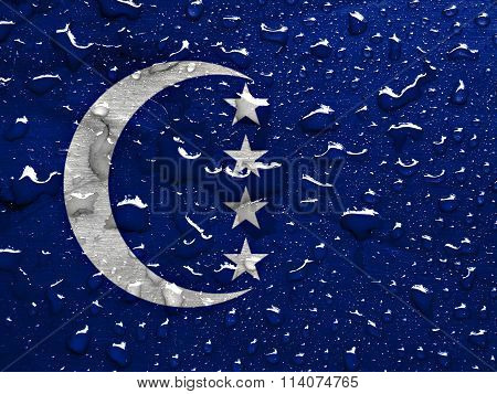 flag of Grande Comore with rain drops