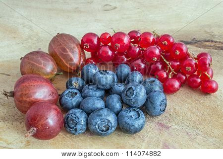 Mixed berries on a wooden board