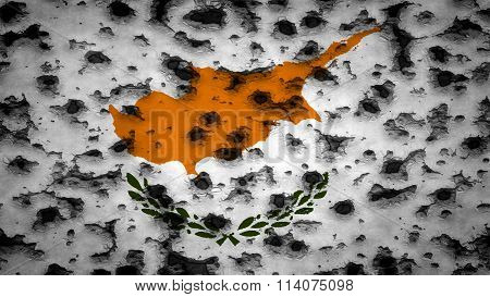 Flag of Cyprus painted on wall with bullet holes