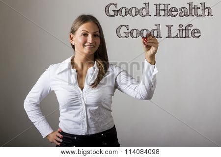 Good Health - Good Life - Beautiful Girl Writing On Transparent Surface