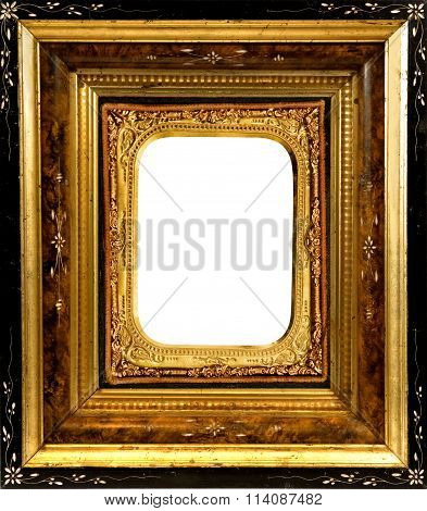 Aged wooden Frame with old ornate Daguerreotype gold metal insert