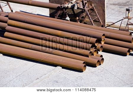 Sunlit Brown Industrial Iron Pipes Pile
