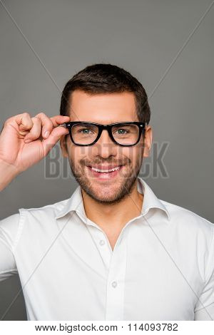 Smart Smiling Man Touching His Glases