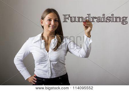 Fundraising - Beautiful Girl Writing On Transparent Surface