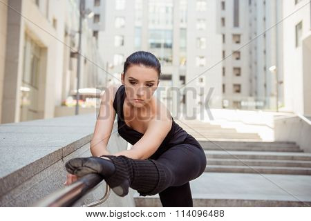 Pretty Young Woman Leaning On The Railing
