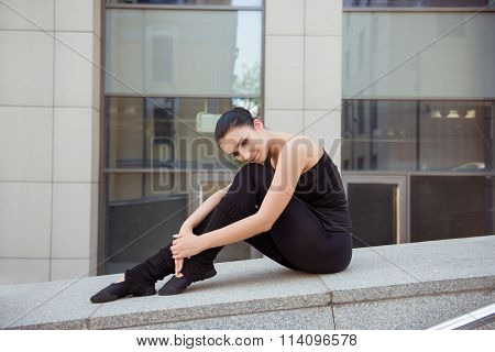 Tender Pretty Ballerina Sitting On The Balusters