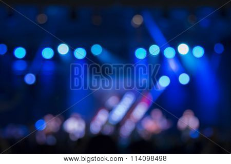 Defocused stage lights and crowd on a concert