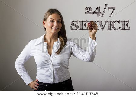 24/7 Service - Beautiful Girl Writing On Transparent Surface