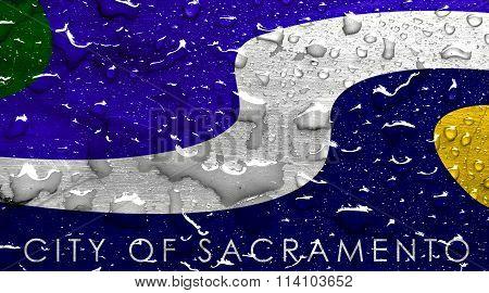 flag of Sacramento with rain drops