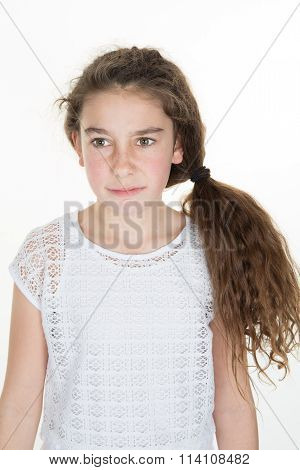 Disgusted And Frowning  Girl On A White Background