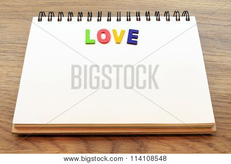 Wood Colorful Letter Word Love Lay Down Notebook On Wood Background