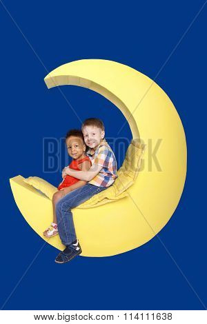 White Boy And Black Girl Sitting On The Moon.