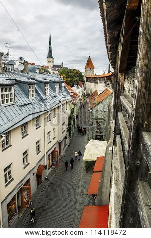 View Of St. Olaf  Cathedral And The Streets Of Old Tallinn City Wall.