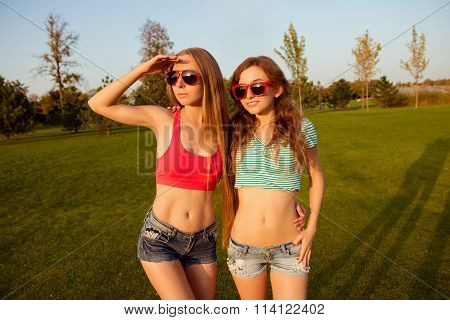 Two Young Sexy Girls With Shapely, Toned Body Watching Sunset
