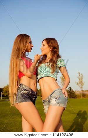 Two Young Sexy Girls Holding Each Other In The Park