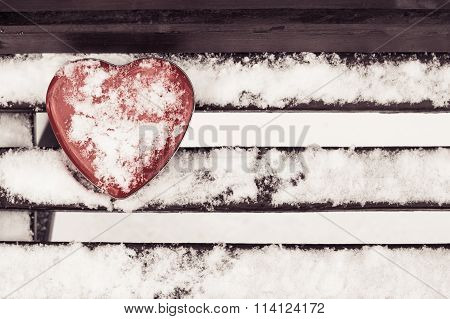 Red Heart Shaped Tin Box On A Bench