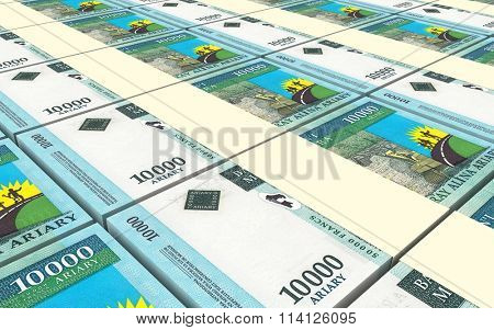 Malagasy ariary bills stacks background. Computer generated 3D photo rendering.