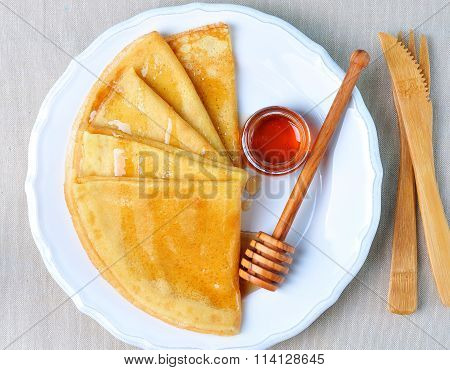Homemade pancakes with maple syrup or honey