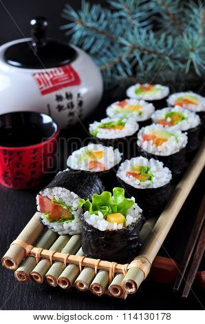 Vegetarian homemade sushi with avocado, tomato, peppers and lettuce.