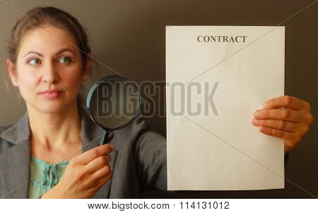 Business Woman With Contract And Loupe