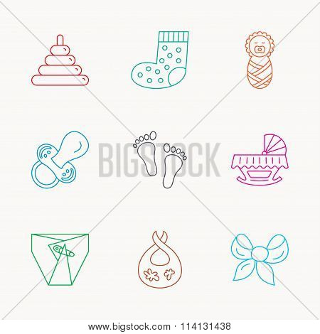 Pacifier, diapers and newborn icons. Footprint.
