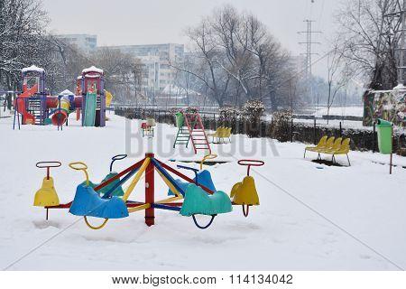 Empty Children Playground In The Snow.