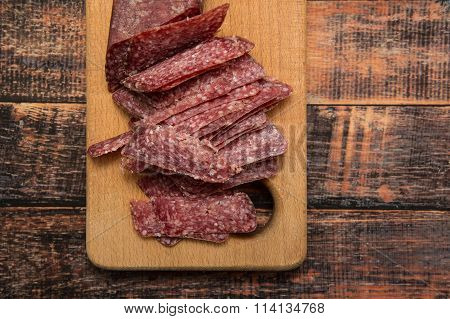 Sliced Meat Appetizer Over Wooden Background
