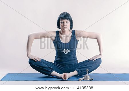 Young woman doing yoga exercise.