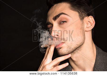 Model man smoking in studio