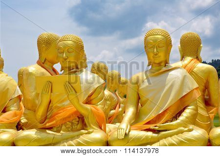 Statue Of Saint Priest In Buddhism With Bright Sky Background.