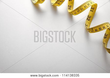 Yellow Tape Measure In Meters And Inches Background