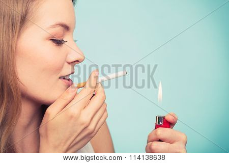 Girl Using Lighter To Light Cigarette.