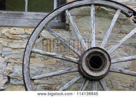 Wagon wheel against a wall