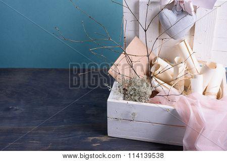 Wedding or valentines theme. Bridal veil, invitation scrolls, pink silk laces, envelopes.Copy space.