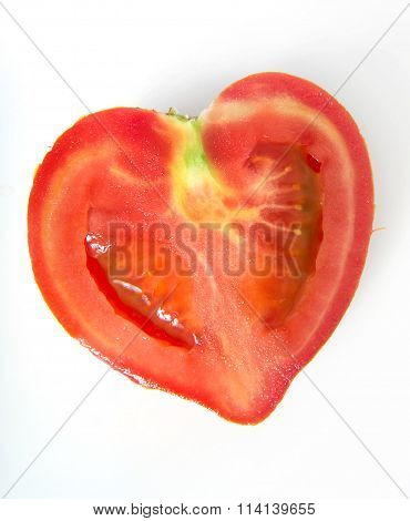 single half of heartshaped tomato isolated on white background