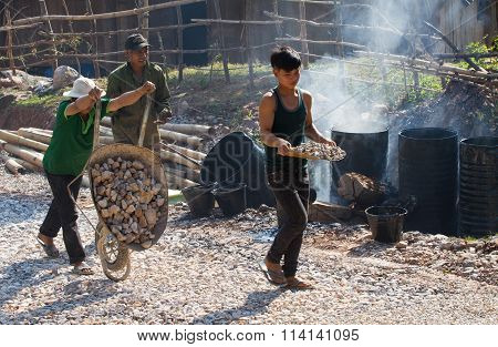 Road construction site with Asian workers